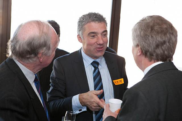 Paul Nicolaou (centre) talking to guests